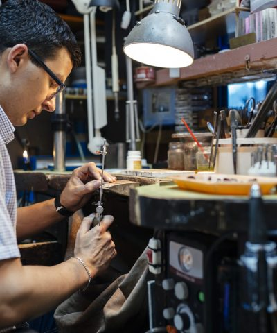Jeweler desining jewelry in workshop
